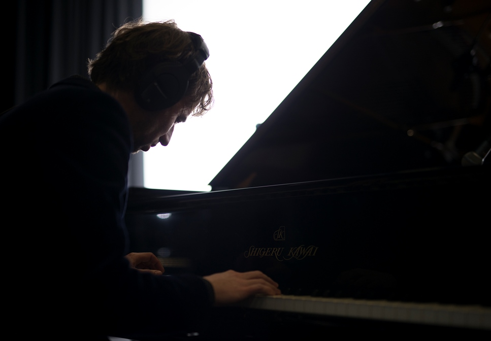 Photo of Sean Foran playing the piano
