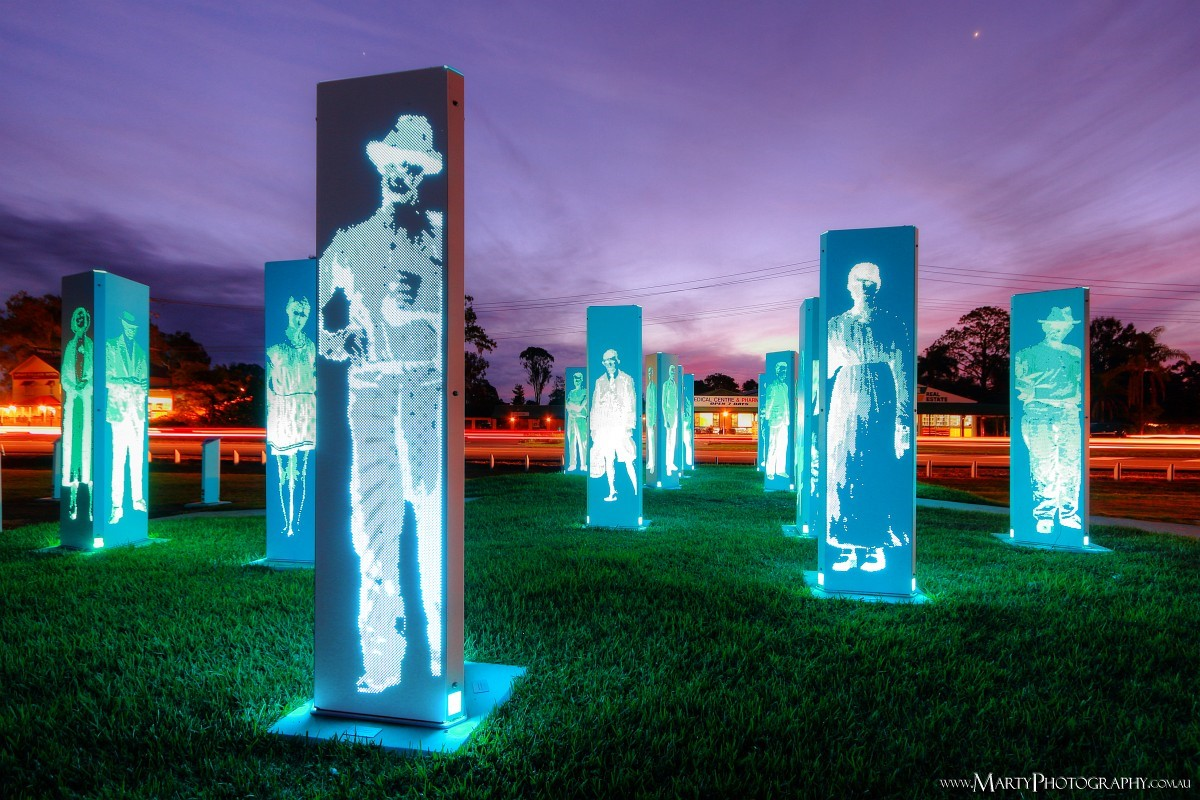 Forest of Memories public art installation features historic figures from Logan Village's past and is illuminated from sunset to sunrise. Photograph by Marty Pouwelse.